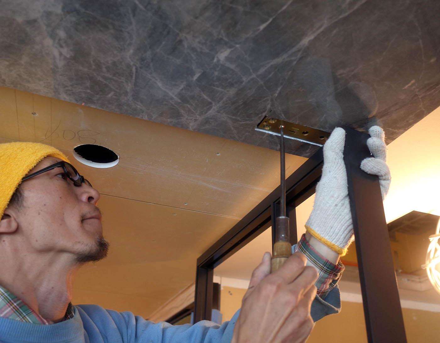 廊下からリビングへの鋼製建具吊り込み@高級マンションリノベーション